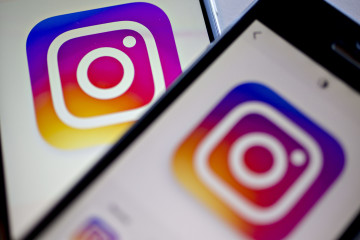 Facebook Inc.'s Instagram logo is displayed on the Instagram application on an Apple Inc. iPhone in this arranged photograph taken in Washington, D.C., U.S., on Friday, June 17, 2016. In a bid to give its users an incentive to create more content for the photo and video-sharing site, Facebook's Instagram is considering sharing revenue generated from news, sports, celebrities and other content said Carolyn Everson, vice president for global marketing solutions at Facebook. Photographer: Andrew Harrer/Bloomberg via Getty Images